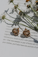 Flat Lay of Gold Knotted Stud Earrings