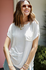 White - Model wearing a Luxe Knit Tee with denim shorts