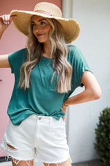 Teal - Model wearing a Luxe Knit Tee with a straw hat