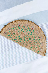 Flat Lay of a Straw Beaded Clutch
