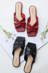 Flat Lay of black and red Square Toe Slide Sandals