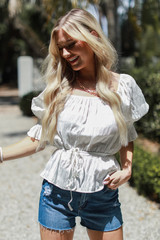 Model wearing a Smocked Blouse