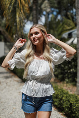 Dress Up model wearing a Smocked Blouse