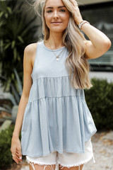 Denim - Model wearing a Tiered Tank with white shorts
