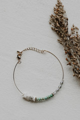 Flat Lay of a Beaded Bracelet in White