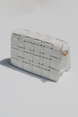 White - Flat Lay of a Woven Crossbody Bag