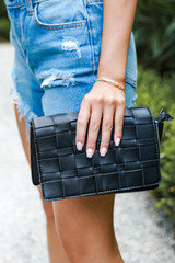 Close Up of a Woven Crossbody Bag in Black