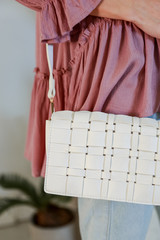 Close Up of a Woven Crossbody Bag in White