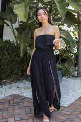 Model wearing a Polka Dot Strapless Jumpsuit with heels