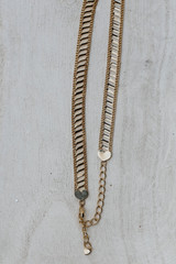 Flat Lay of a Gold Heart Necklace