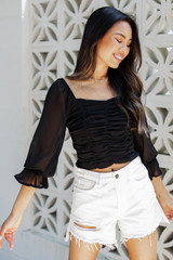 Dress Up model wearing a Ruched Cropped Blouse