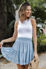 Denim - Model wearing a Smocked Tiered Mini Skirt with a white tank