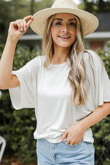 White - Model wearing a Twist Back Top with denim shorts