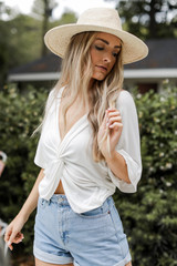 White - Dress Up model wearing a Twist Back Top with denim shorts