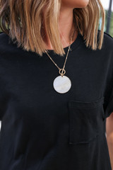Model wearing a Shell Necklace