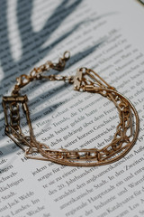 Flat Lay of a Gold Layered Chain Bracelet