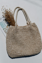 Flat Lay of a Straw Tote Bag