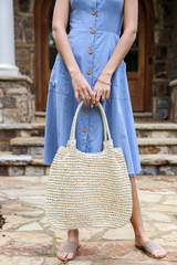 Model holding a Straw Tote Bag