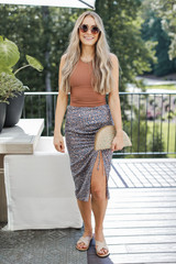 Model wearing a Leopard Midi Skirt with a cropped tank