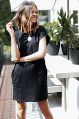 Black - Dress Up model wearing the Everyday T-Shirt Dress with a necklace
