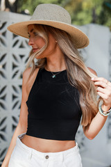 Black - Model wearing a Seamless High Neck Tank with a straw hat