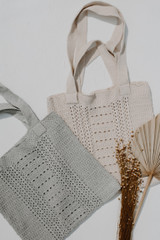 Flat Lay of both colors of the Crochet Knit Tote Bag