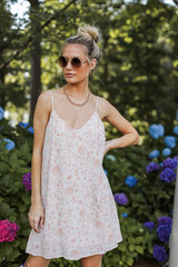Model wearing a Floral Swing Dress with sunglasses