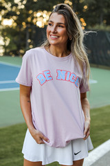 Model wearing the Be Nice Graphic Tee