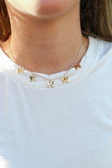 Model wearing a Gold Butterfly Necklace