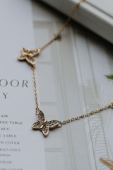 Close Up of a Gold Rhinestone Butterfly Necklace