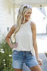 Taupe - Model wearing an Everyday Jersey Tank with denim shorts