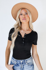 Dress Up model wearing a Button Front Bodysuit