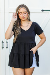 Black - Dress Up model wearing a Tiered Babydoll Top with denim shorts