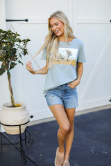 Model wearing the Your Only Limit Is Your Mind Graphic Tee with denim shorts