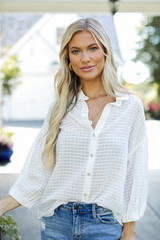 Model wearing a Button-Up Top in White