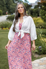 Model wearing a Floral Maxi Dress with a white blouse