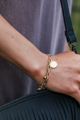 Model wearing a Gold Coin Layered Bracelet