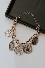 Flay Lay of a Gold Coin Bracelet
