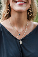 Model wearing a Gold Beaded Layered Necklace
