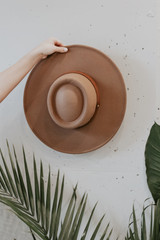Flat Lay of a Wide Brim Banded Hat in Khaki