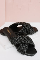 Flat Lay of Braided Slide Sandals in Black
