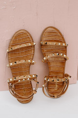 Studded Sandals in Tan on a pink background