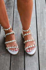 Model wearing Studded Sandals in White