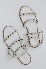 Studded Sandals in White on a background