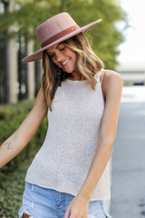 Model wearing a Knit Tank with denim shorts