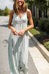 Model wearing a Maxi Dress with white booties