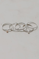 Silver - Flat Lay of a Pearl Ring Set