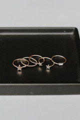 Flat Lay of a Gold Star Ring Set