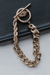 Flat Lay of a Gold Chain Bracelet