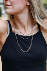 Model wearing a Gold Star Layered Necklace